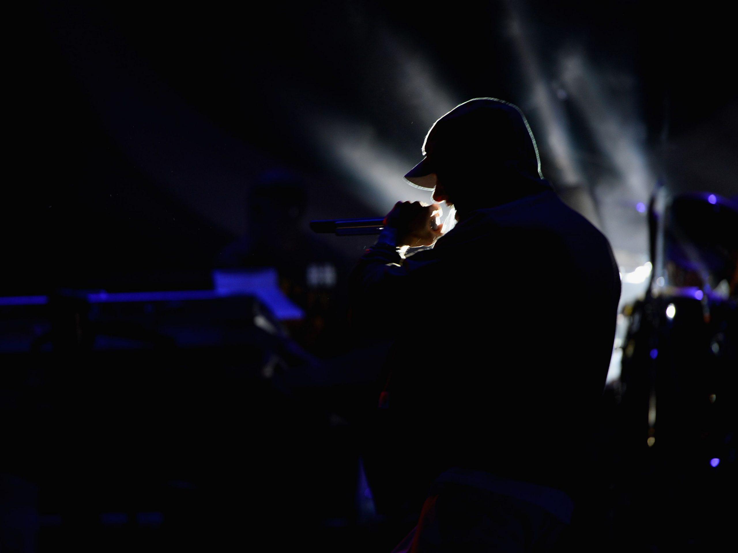 A man sitting in a dark room