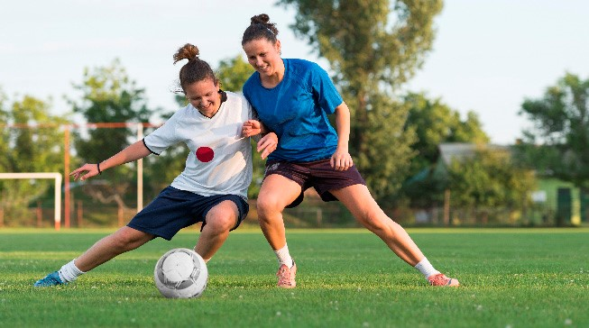 A girls playing a game of football
